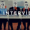 Why You Need to Ask These 20 Accounting Interview Questions — People at table holding question-mark signs in front of faces, and the words Effective Interview Questions