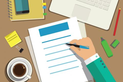 How to Craft a Better Accountant Cover Letter — graphic of office desk with hand holding pen